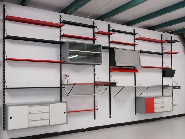 Beautiful extra large Pilastro modular wall system. In 1955 Tjerk Reijenga promoted his metal modular shelving system in Dutch interior magazine ''Goed Wonen'' the various possibilities of the system and the norm range of different product for the