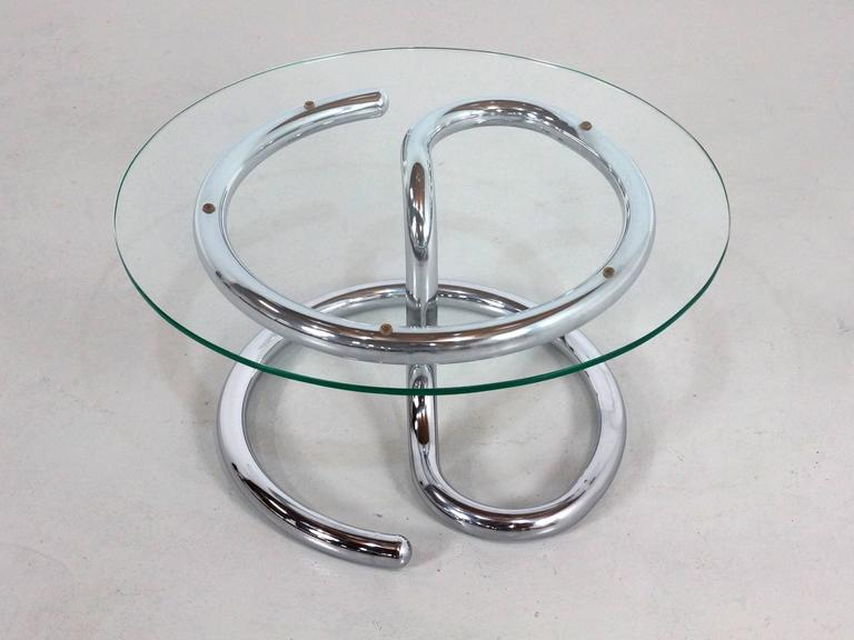 Beautiful small size (74 cm diameter), side or coffee table designed by Paul Tuttle in the 1970s the chrome base look like a snake and thats where the name come from, chrome is in good condition with minor use marks consisting with the age. The 1 cm