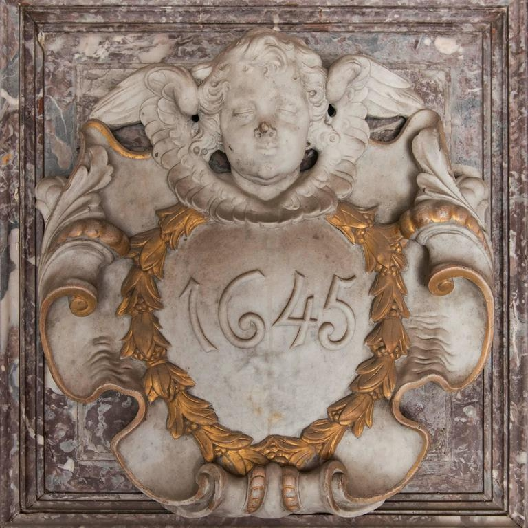Monumental chimneypieces as these are quite rare to find. The house owners which could afford a mantel like this often preserved it through many generations. This Baroque inspired piece comes from a Antwerp townhouse which was converted to a hotel.