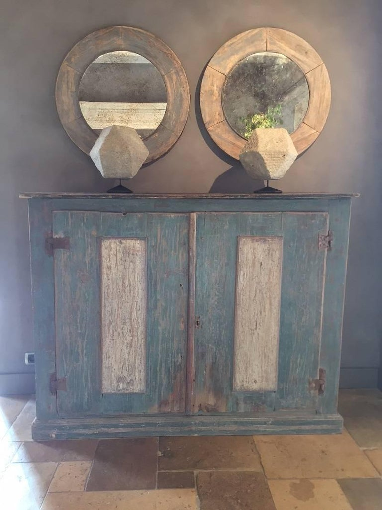 Charming Italian 17th century Buffet with original paint. The piece is made from large softwood boards and painted in an attractive bleu pallet. Its panneled doors have the original iron hinges and are accentuated in darker panneling. The whole
