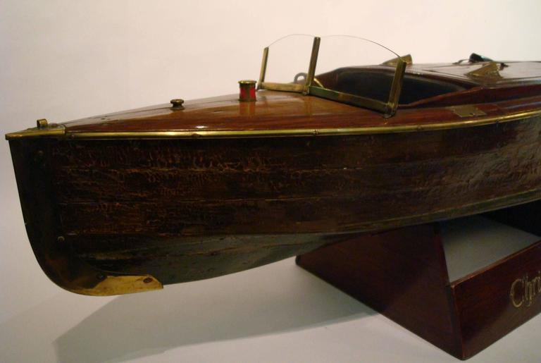 Fantastic Chris craft speedboat sales model, circa 1930s. It belonged to an antique speedboats sales shop. The shop opened in 1912 and closed on the 1965. Perfect for a nautical fan. The speedboat has been re-polished, leaving the original paint