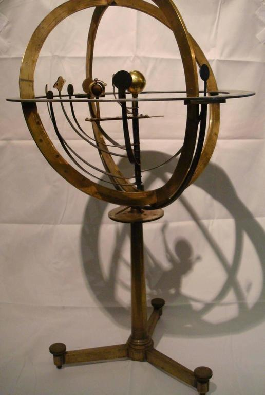 A brass Armillary Sphere. An Attractive Armillary sphere. The sphere with aluminium horizon circle divided in four quadrants with zodiac and calendar scales, the brass vertical circle and ecliptic rules and punched with stars, in the centre a