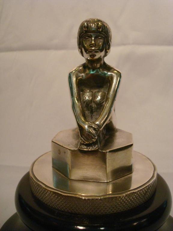 Rare Art Deco silvered bronze statuette of a seated young boy Faun. Car mascot hood ornament. Figure mounted over a car radiator and over a polished wooden base. Perfect desk piece. Signed 'Silvestre' with foundry marks for editions Susse Freres,