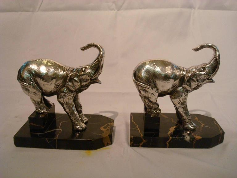 Very nice French bookends. Elephant figures mounted over Italian marble. Silverplated figures. Signed H. Moreau.