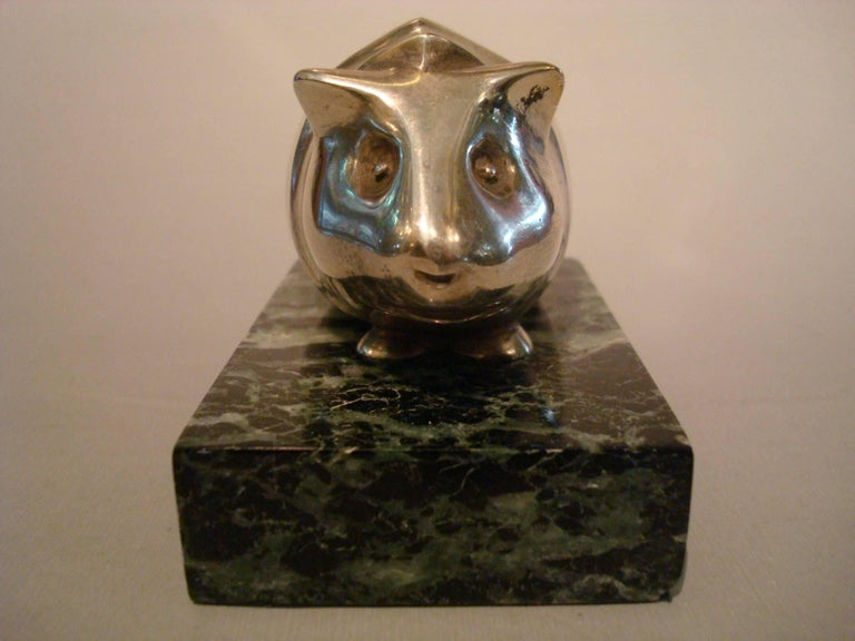 Art Deco Edouard Marcel Sandoz (Swiss, 1881-1971), Guinea pig silver plated bronze paperweight. Mounted over a marble base. Marked: Ed M Sandoz, near the lower edge, also with Susse Fres Ed mark.
