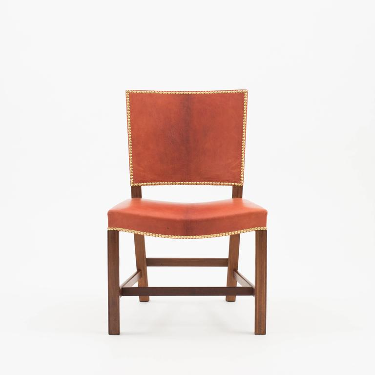 Kaare Klint 'Red Chair' in Cuban mahogany, Niger leather and brass nails. Executed by Rud. Rasmussen 1936-1940.  Underside with manufacturer's paper label RUD. RASMUSSENS/SNEDKERIER/45 NØRREBROGAD/KØBENHAVN, pencilled number and architect's
