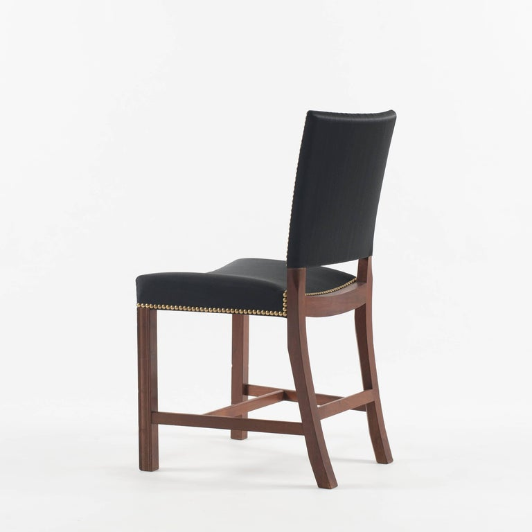 Kaare Klint Red chair. Executed by Rud. Rasmussen.  Cuban mahogany, black horsehair and brass nails.   Underside with manufacturer's paper label RUD. RASMUSSENS/SNEDKERIER/45 NØRREBROGAD/KØBENHAVN, pencilled number and architect's monogrammed paper