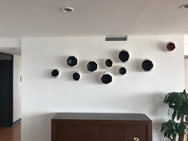 Ceramic pieces designed by Orfeo Quagliata in collaboration with Cerámica la Mejor. The inner colors of this work can be customized. This faceted ceramic pieces come in three different sizes. The installation is very easy, and the composition may be