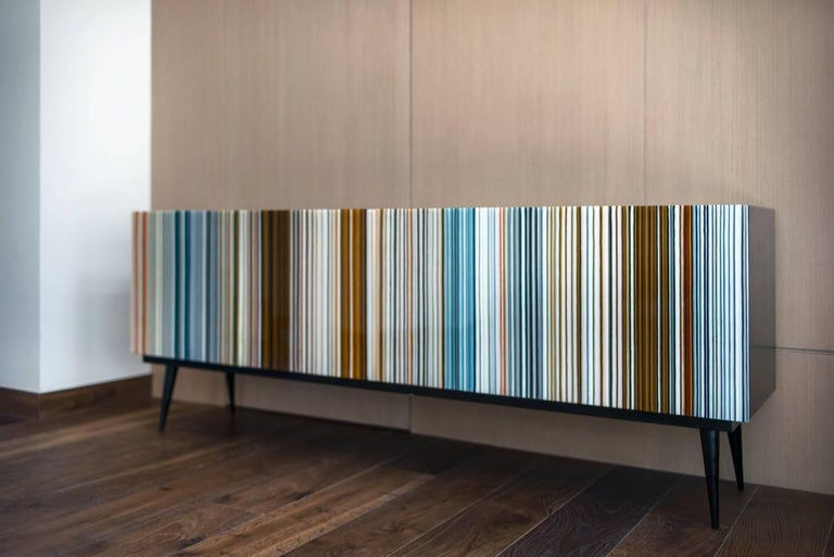 Credenza designed by Orfeo Quagliata in collaboration with Taracea Furniture. An object of fused glass created with the exclusive barcode technique. The Buff-Heyyy´s retro design mixed with designer's exceptional glass expertise put together a