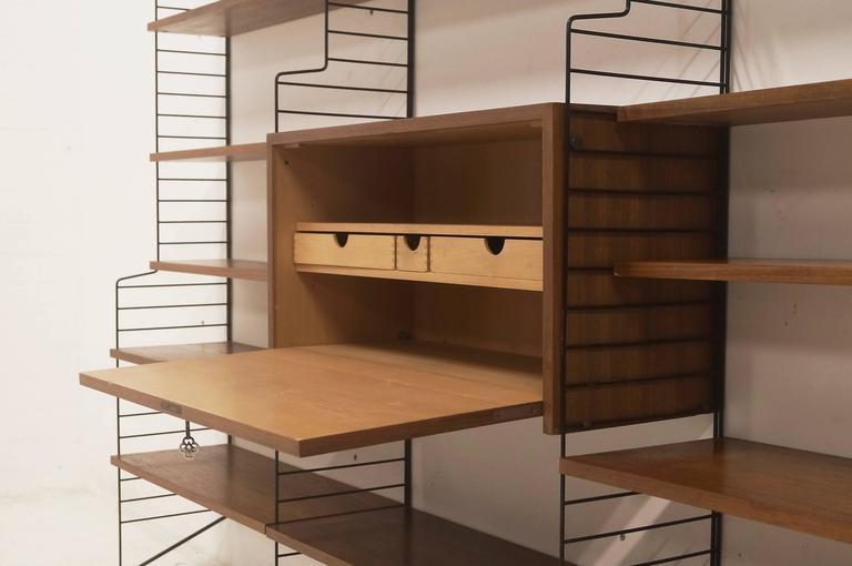 mid century 39 ladder shelf 39 by nils strinning for ab sweden string design 1950 at 1stdibs. Black Bedroom Furniture Sets. Home Design Ideas