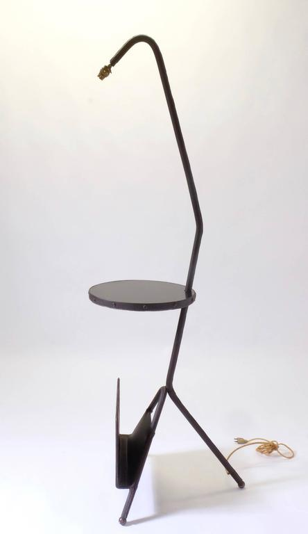 Floor lamp by Jacques Adnet, circa 1950, with magazine rack, brown leather, piqure sellier.