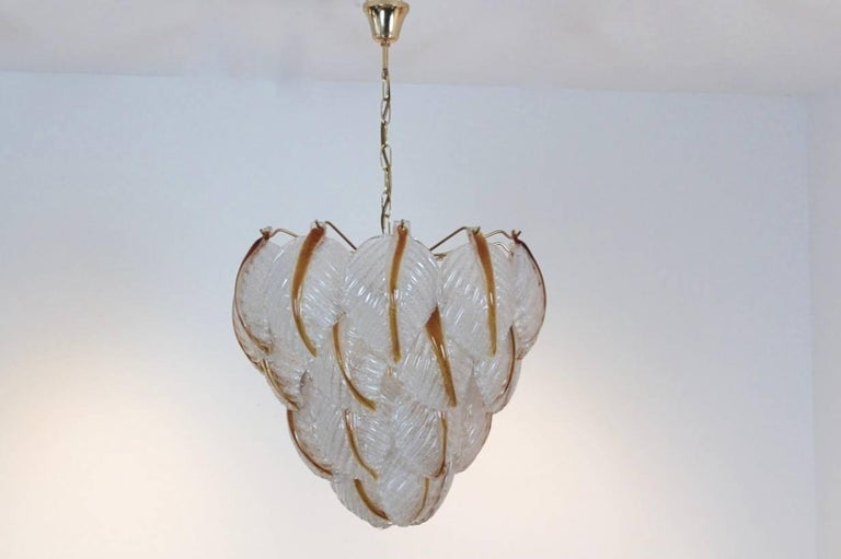 Wonderful chandelier made by A.V. Mazzega with 31 beautiful characteristic Murano frosted glass leaves on a brass base. Manufactured in the early 1970s. Very impressive large glass chandelier and beautiful light effect when lit. In excellent