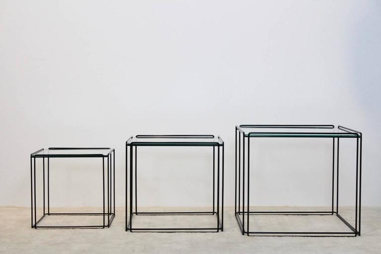 This nest of three Isocele nesting tables originates from France and was manufactured in the 1970s by Arrow. They have a black wire steel frame with glass on top. Designed by Max Sauze and are in very good vintage condition. These Minimalistic