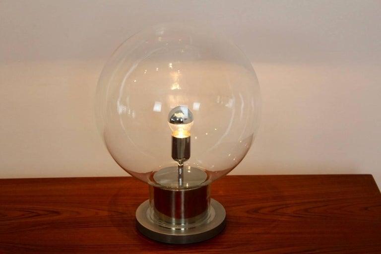 Unique RAAK table lamp in excellent condition. Designed and made by RAAK Amsterdam, Holland. Very rare and beautiful lamp with a chrome base ad a glass globe all around it. Very large glass globe and fantastic performance. Iconic Dutch design.