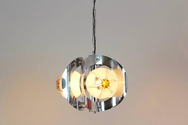Wonderful chandelier made by A.V. Mazzega with three beautiful characteristic Murano frosted glass bowls on a stunning chrome base with three lights. Manufactured in the early 1970s. Very impressive glass chandelier and beautiful light effect when