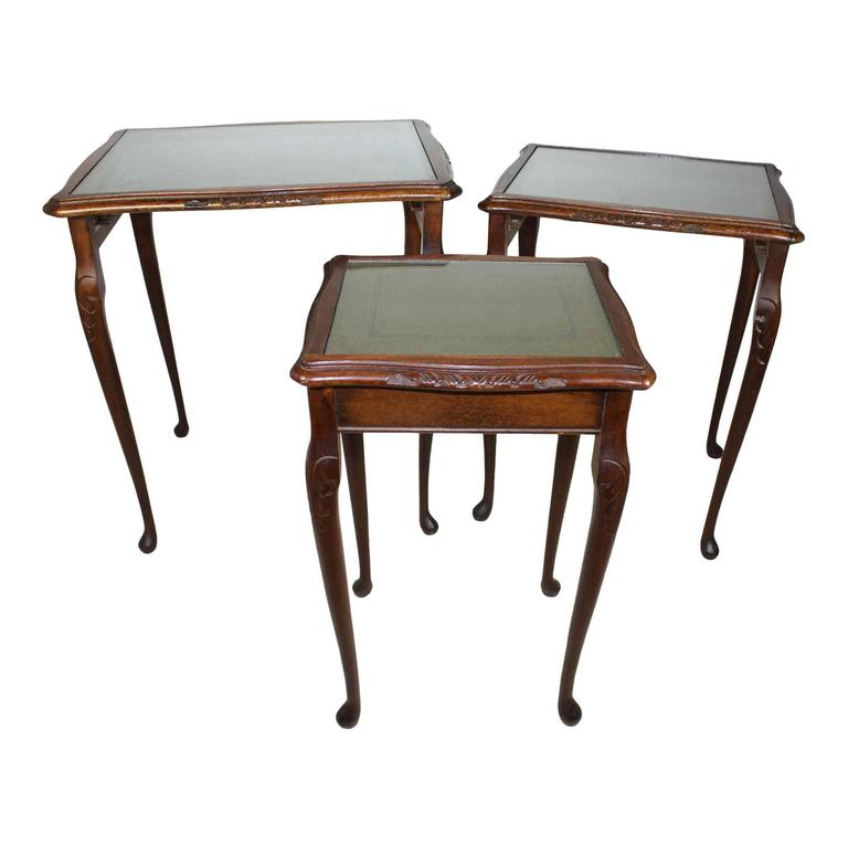 Leather Nesting Tables ~ English nesting tables with gilt leather tops circa