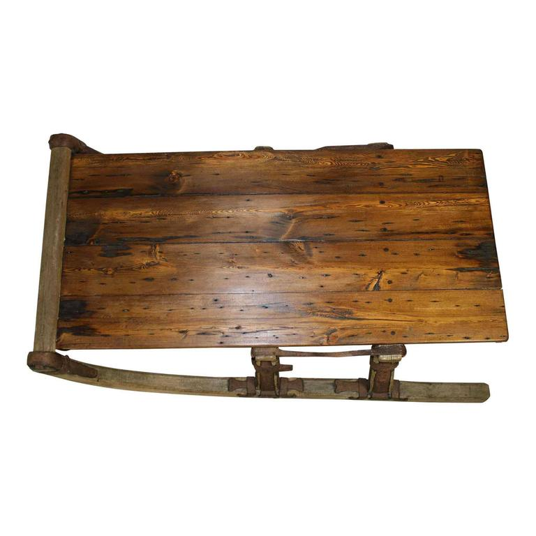 This runners of this re-purposed Russian sleigh, with lovely iron embellishments, has been made into a great looking coffee table. Reclaimed barn wood has been use for the tabletop, finished in a pleasing walnut stain.