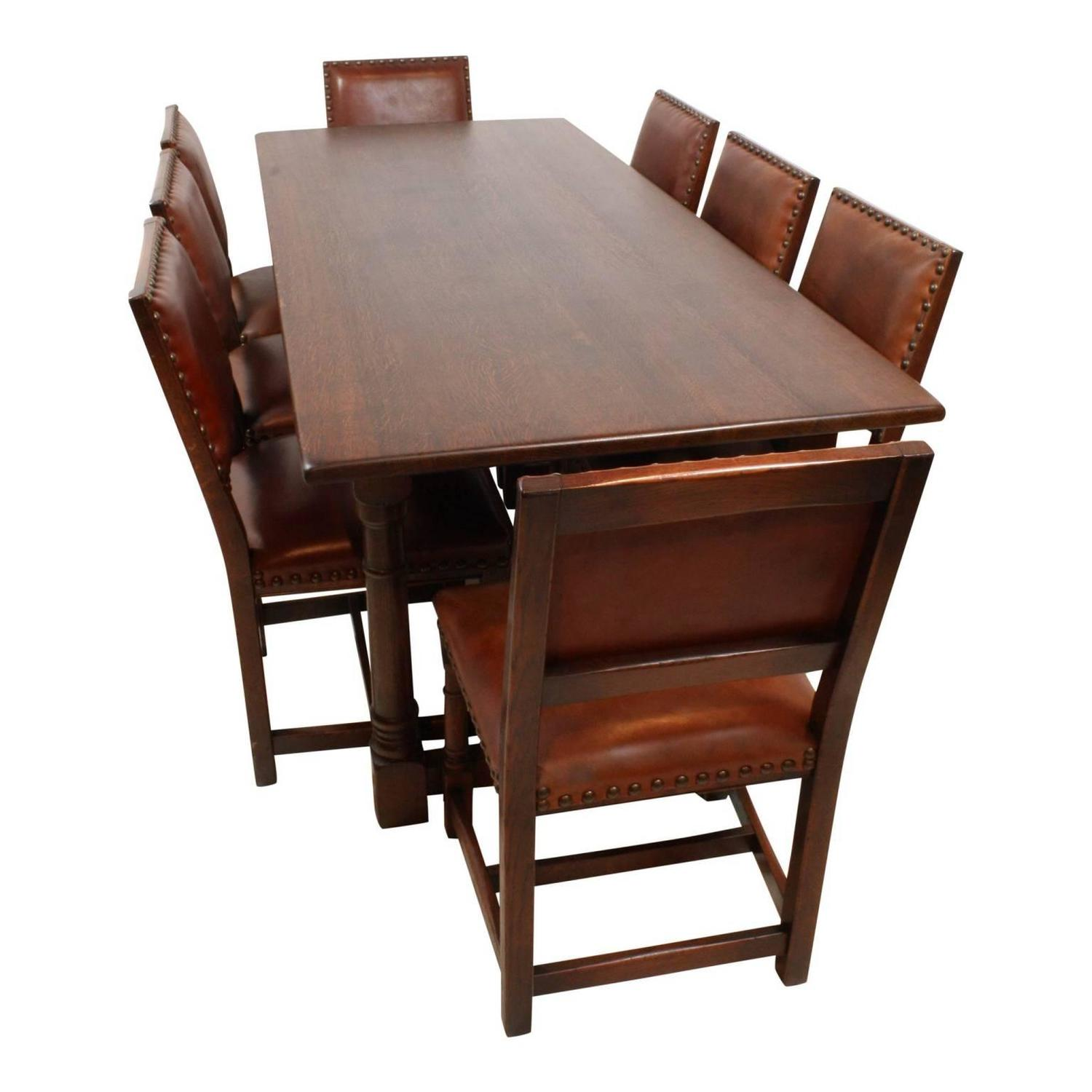 mid 20th century oak dining room table with eight leather chairs for