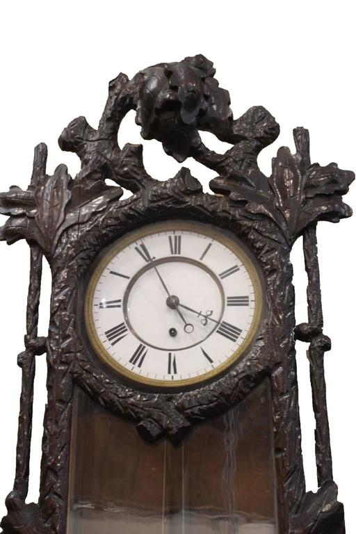 Late 19th century Vienna regulator single weight wall clock in a carved walnut and glass case. Because of the style of case, which is unlike most cases made in Austria, it is likely the case was carved in Germany or Switzerland and then fitted with