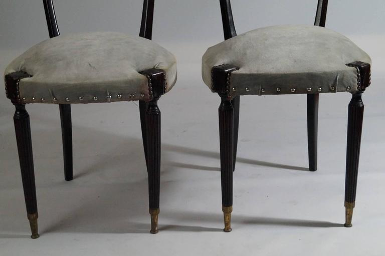 Beautiful pair of modern style ladder back chairs.