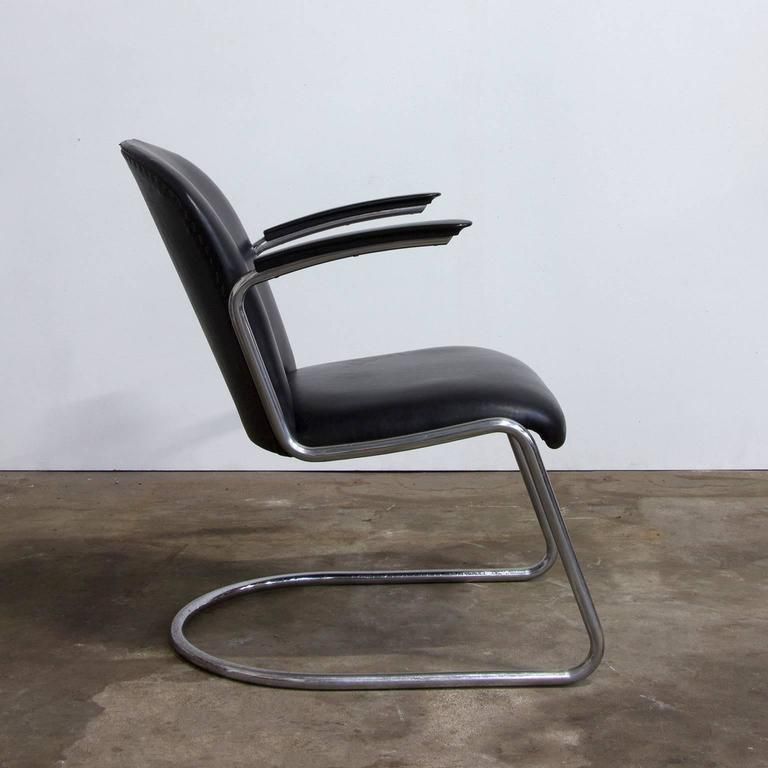 Very rare original chrome chair with different frame, a bit going into the seat, different as most of the 413 easy chairs. Gisolite armrest. Artificial Leather/Leatherette or vinyl upholstery is in good condition, except for some damage on top of