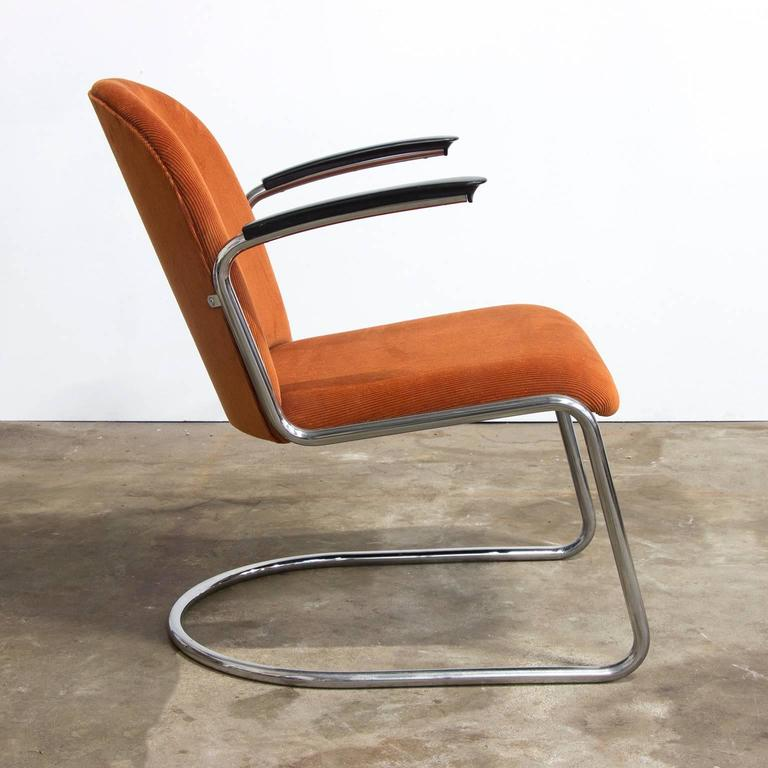 Chrome version, very comfortable original easy chair, recently new upholstered in orange or rusty brown Corduroi or Manchester. The base is in very good condition.  This is the original version including the original Gisolite armrests.  Weight 12