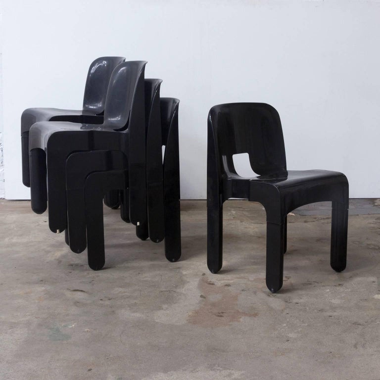 Set of seven Kartel plastic chairs in black. Traces of wear like scratches (see picture #8). One of the plastic legs will fall off when the chair when you lift the chair, but can still be used for sitting and one of the legs has a crack on top, but