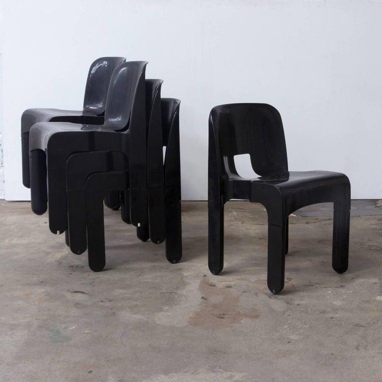 8 Zwarte Design Stoelen.1967 Joe Colombo Universale Plastic Chair Type 4867 Three