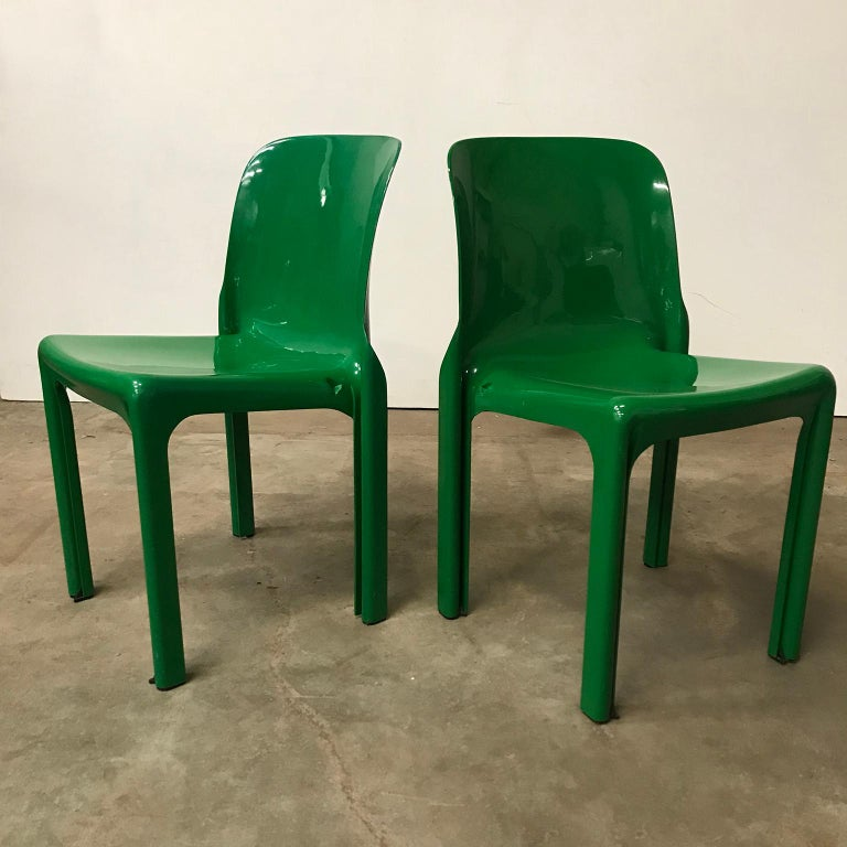 Set of four Selene chairs in apple green. One of these chairs has a slightly different color green but with the total set it is hardly visible (Picture 10 does not show the accurate color, because it is more alike the other greens). The chairs are