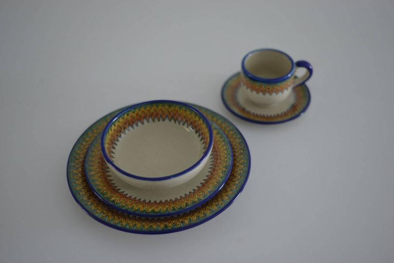 Handmade dinnerware service for 12. It contains: 12 dinner plate 27 cm. 12 salad plate 20 cm.  12 soup bowl 15 cm. 12 bread plate 14 cm. 12 coffee cup 7 cm. 12 espresso cup. 12 butter plate.   Serving pieces: One roud plate 41