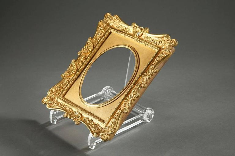 Gilt bronze frame with curved sides, very intricately sculpted with shells, flowery palmettes, small flowers and foliage. Very beautiful chasing,