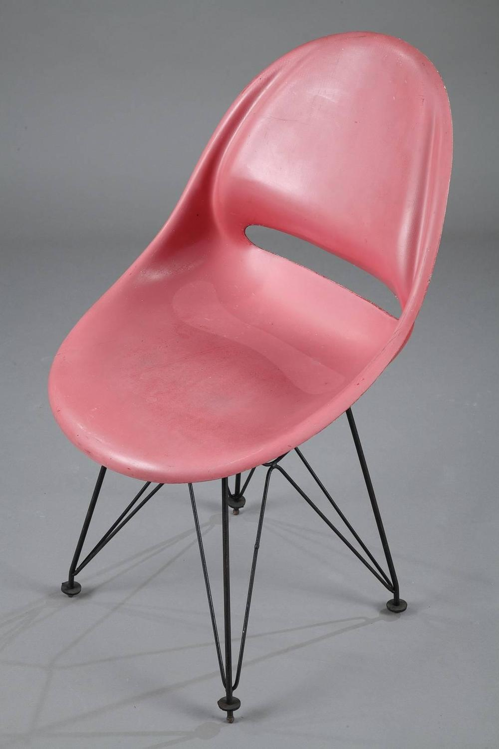 set of four seats with eiffel tower legs after eames for