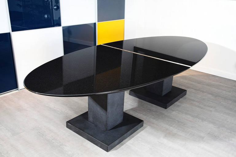 imposing black granite dining room table by michael