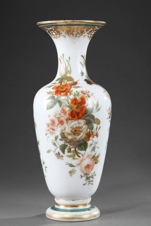 Pair of baluster-shaped vases in white, enameled Opaline, decorated with red, white and blue bouquets of flowers. The collar is embellished with gilded arabesques and the base features golden and blue stripes. Light wear to the