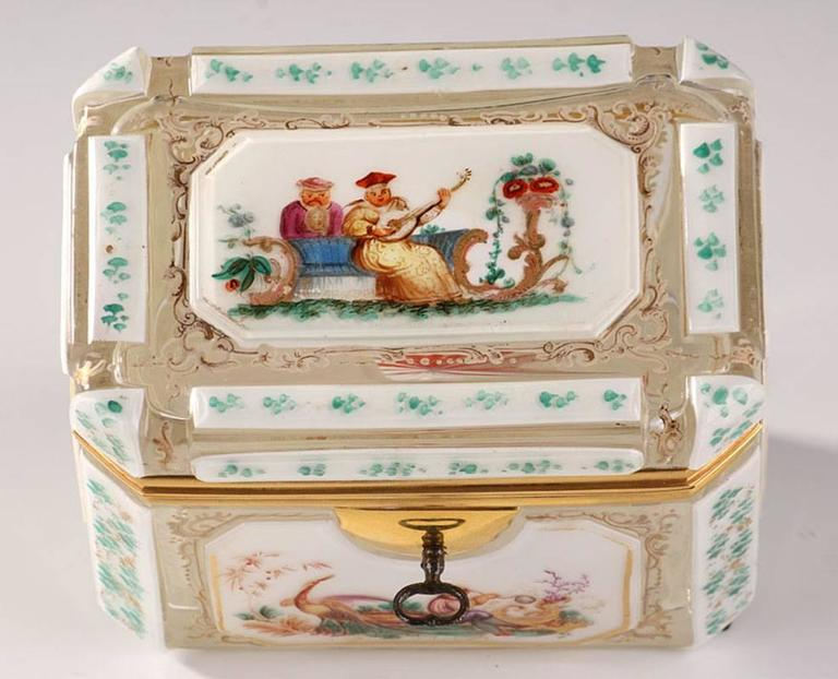 Rectangular jewelry box in overlay with polychromatic decorations of