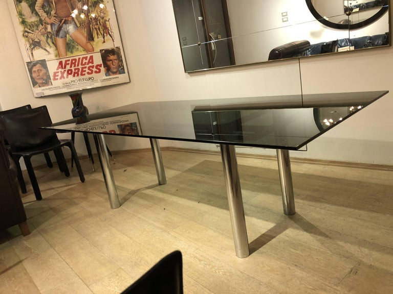 Smoked glass top and steel legs for this table designed by Italian designer Tobia Scarpa in 1960s for Gavina.