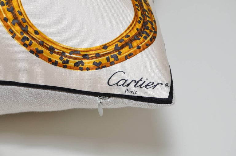 Custom-made one-of-a-kind luxury cushion (pillow) created from an exquisite vintage pure silk Cartier fashion scarf. It features their signature bejewelled bracelet with iconic panthers meeting head to head repeated across the silk in a set of six,