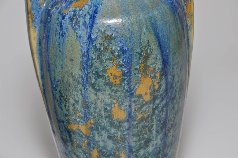 A spectacular pair of French art pottery made by the 'Faienciere Heraldique de Pierrefonds', a pottery established in 1903 by Olivier de Sorra, Count Hallez D'Arros, at Pierrefonds, a village in Picardy, south of Paris, at the foot of the famous