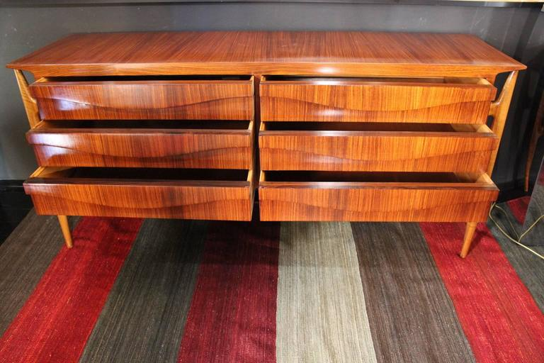 1960s rosewood and sycamore chest of drawers.  It is an article that requires CITES certification and the shipping costs for the USA are very high