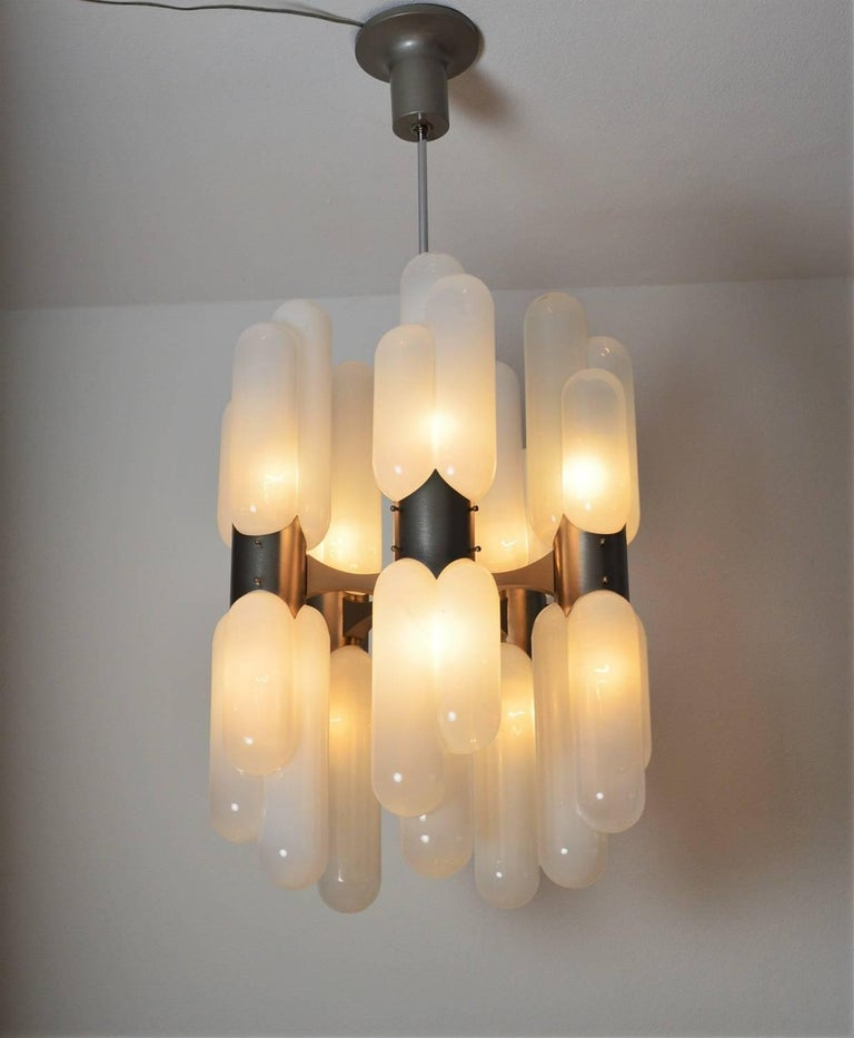 Beautiful chandelier called Torpedo, designed by Carlo Nason and manufactured in Italy by Mazzega during the midcentury. The Murano glasses are opalescent, all handmade, all ten glasses are in excellent condition without visible defects. The lamps