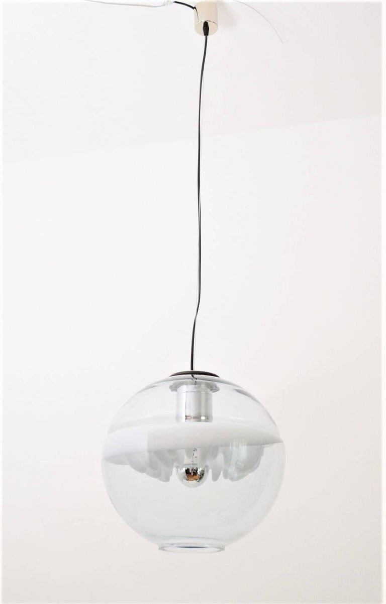 Sculptural gorgeous ceiling or pendant lamp designed from Toni Zuccheri and produced from Venini in the 1970s. The lamp is composed of two half glass globes with an internal gorgeous glass detail of white color. Please for one Edison bulb. Depending