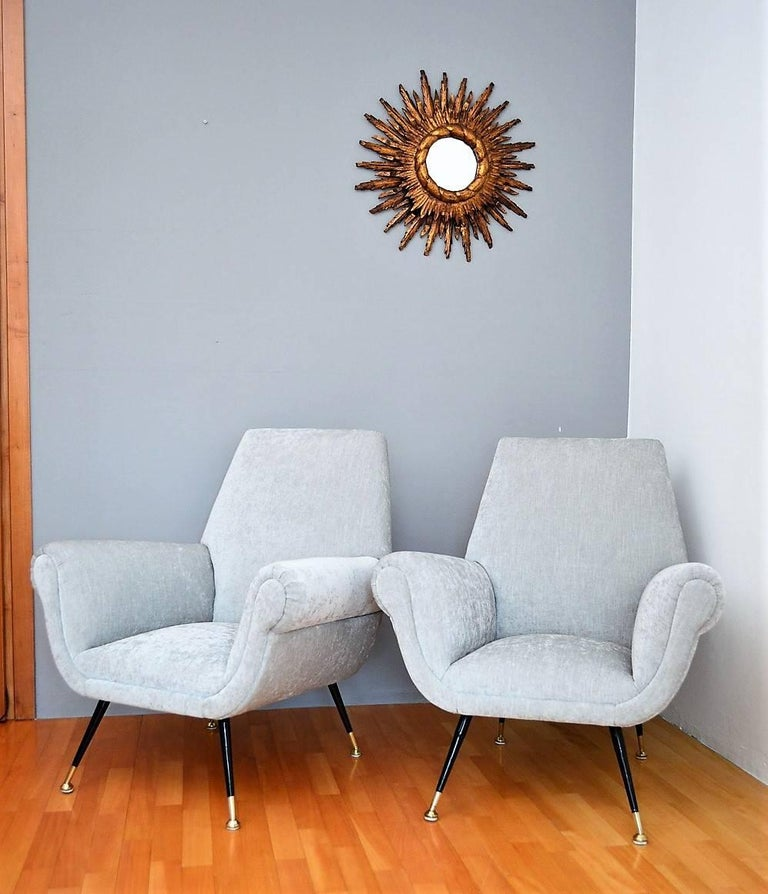 Beautiful and very comfortable pair of Italian midcentury armchairs or lounge chairs, original of the 1950s with brass stiletto feet and soft velvet in elegant light grey - silver white color. A typical shape of Italian Elegance. Designed from