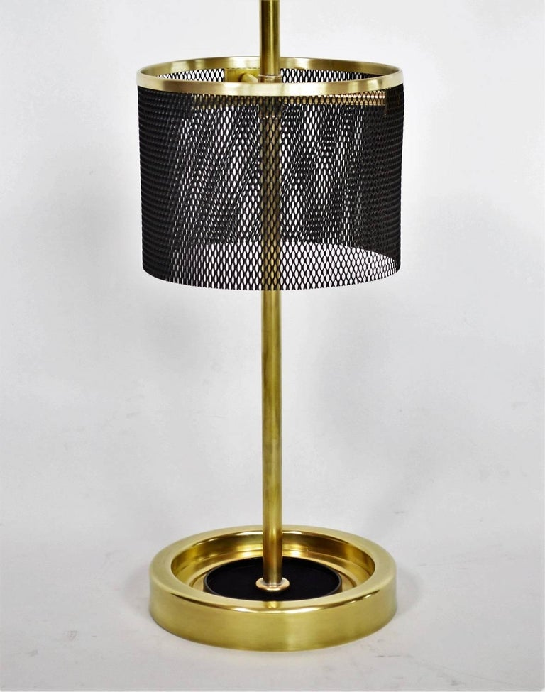 Gorgeous umbrella stand made of full brass and perforated metal with Bakelite knob in the style of Mathieu Matégot. Manufactured in Italy in the 1950s, excellent design and highest craftsmanship. The umbrella stand have been fully restored, the