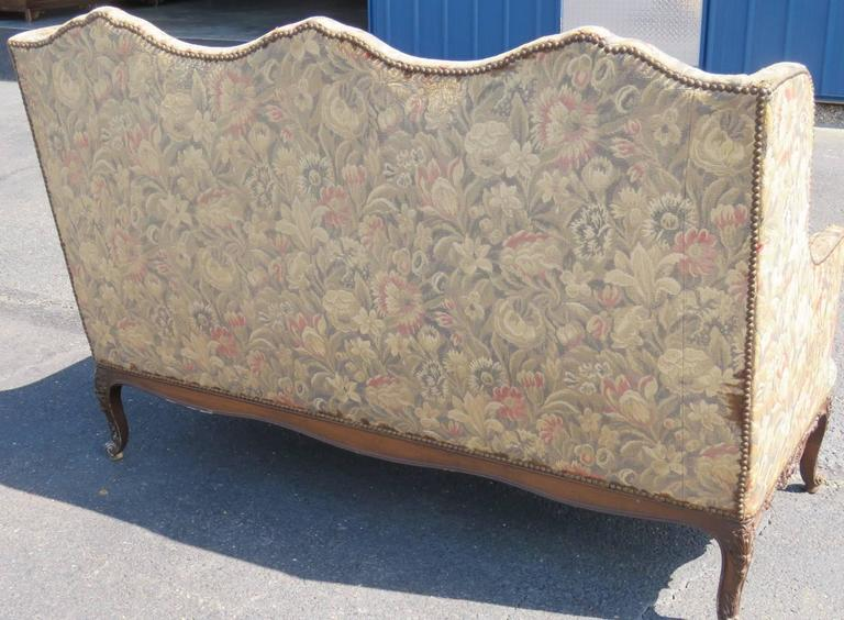 Floral tapestry upholstered. Carved walnut feet.