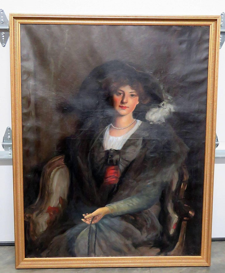 Antique oil painting of a woman in a gilt frame. This is from the John DeLorean estate in New Jersey. The painting itself is 48