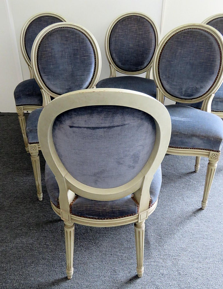 Set of 6 Louis XVI style distressed painted dining side chairs with nail head trim.