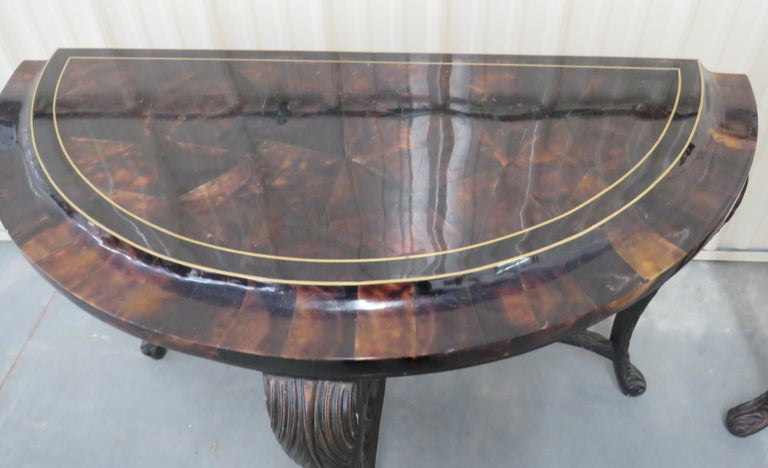 Pair of Regency style distressed finish demilune console tables with tessellated tops.