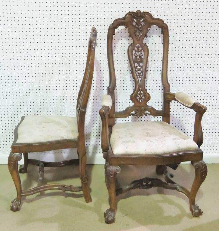 Walnut carved frames with upholstered seats and arms. Set includes two armchairs and six side chairs.
