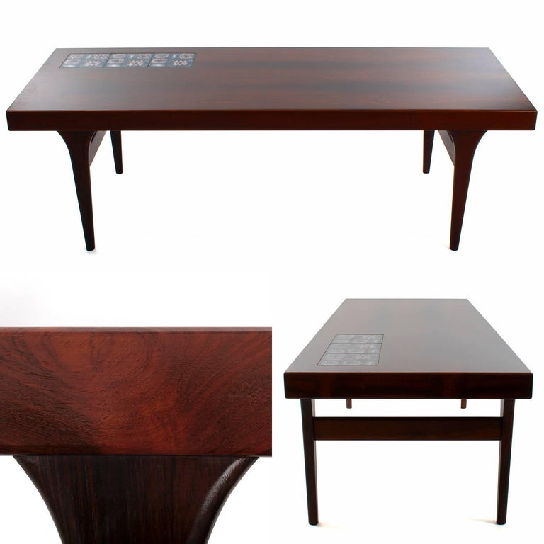 Rosewood coffee tableby Johannes Andersen for CFC Silkeborg in the 1960s - gorgeous coffee table with Royal Copenhagen tiles, in very good vintage condition.  An exquisite midcentury piece, crafted in rosewood, rich in color and showing the