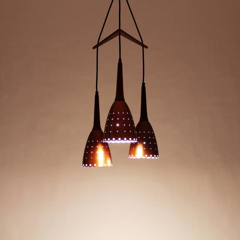 Very Attractive Design Copper Light Fixtures. Copper and rosewood pendant fixture by unknown producer in the 1960s  Extremely attractive trio of Rosewood Pendant Fixture Danish Lamps